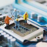engineers on a microchip