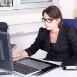 woman secretary in front of monitor